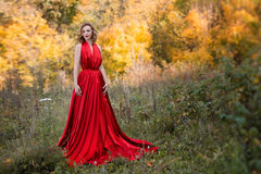 Queen of autumn. Golden autumn in Russia. The girl in the red dress. Autumn colors. Forest in autumn. Queen of autumn Royalty Free Stock Photos