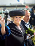Queen Beatrix. Of the Netherlands during a visit in a harbour, friendly smiling and waving at the public