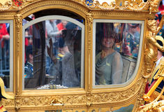 Queen Beatrix and Princess Maxima. THE HAGUE, HOLLAND - SEPT 20: The golden carriage with Queen Beatrix and royal Princess Maxima on Prinsjesdag (opening of Stock Photo