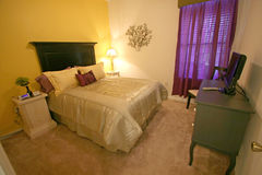 Queen Bedroom. An Interior Home shot of a Queen Bedroom Royalty Free Stock Photos