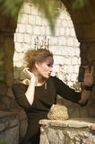 Queen in a black dress. Lovely Queen climbs the stairs Royalty Free Stock Photo