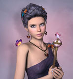 Queen of butterflies. Portrait of a beautiful woman with scepter and butterflies Royalty Free Stock Image