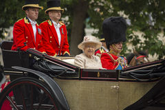 Queen in carrage. Queen Elizabeth II in an open carriage with Prince Philip. Trooping the colour 2015 marking the Queens official birthday, London, UK Stock Photo