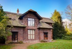 Queen Charlottes Cottage in Kew Gardens Southwest London England. Thatched Queen Charlotte`s Cottage at Kew Gardens  botanical garden in southwest London, UK Stock Photography