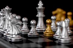 Queen chess set with enemy background. Queen chess set with enemy on black background Royalty Free Stock Image