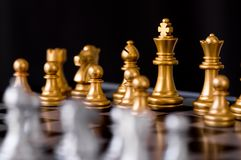 Queen chess set with enemy background. Queen chess set with enemy on black background Stock Photography