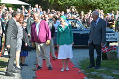 The Queen of Denmark. NYORD, MOEN - SEP 06: Queen Margrethe II and Prince Henrik are visiting the Nyord exhibition at Queens Margretes visit on September 6, 2013 Royalty Free Stock Photo
