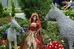 Queen doll in royal gown. Queen doll in between metallic horses Royalty Free Stock Images