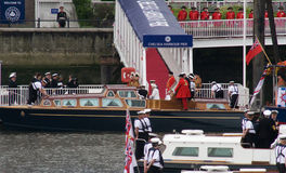 Queen and Duke of Edinburgh board the Royal Launch. Queen Elizabeth II and the Duke of Edinburgh, along with their footmen on the royal launch, at the start of Stock Images