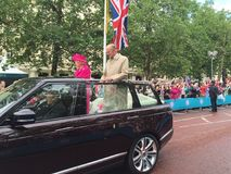 Queen and duke of Edinburgh. Queen Elizabeth second and husband Phillip driving in an open top Range Rover down the mall waiving at crowds. Duke Phillip Stock Photo