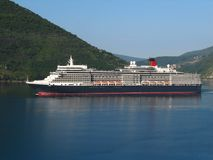 Queen Elizabeth in the bay of Boka Kotorska stock photos