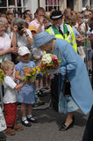 Queen Elizabeth and children Stock Image