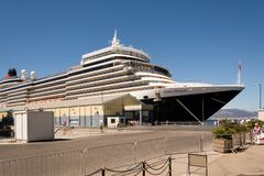Queen Elizabeth Cruise Ship in Gibraltar. PORT OF GIBRALTAR /GIBRALTAR  – JULY 30 2015: Queen Elizabeth cruise ship operated by Cunard docked during a sunny Stock Photos