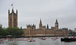 Queen Elizabeth Diamond Jubilee Pageant. A flotilla of boats sail past Houses of Parliament in London on June 3rd during the Royal Pageant, part of the Diamond Royalty Free Stock Photo