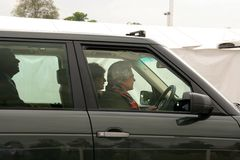 Queen Elizabeth driving car. Queen Elizabeth driving back to Windsor castle Royalty Free Stock Photography