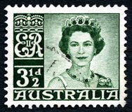 Queen Elizabeth II Australian Postage Stamp. AUSTRALIA - CIRCA 1959: A used postage stamp from Australia, depicting a portrait of Queen Elizabeth II, circa 1959 stock photography
