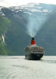 Queen Elizabeth II cruiseship. Queen Elizabeth II, considered the most famous ship of the world. Shot in Geirangerfjord, Norway Royalty Free Stock Images