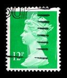 Queen Elizabeth II - Decimal Machin serie, circa 1986. MOSCOW, RUSSIA - FEBRUARY 14, 2019: A stamp printed in United Kingdom shows Queen Elizabeth II - Decimal stock photography