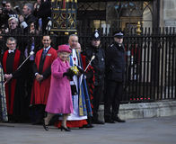Queen Elizabeth II marks Commonwealth Day. LONDON - MARCH 12: Queen Elizabeth leaves Westminster Abbey after the Commonwealth Day ceremony on March 12, 2012 in Stock Photography