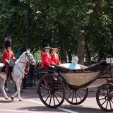 Queen Elizabeth II travels along The Mall in an open carriage pulled by horses, on her way to the Trooping of the Colour parade. royalty free stock images