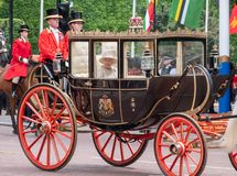 Queen Elizabeth II in a carriage pulled by horses on her way to Buckingham Palace after the Trooping the Colour parade, London UK