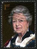 Queen Elizabeth II UK Postage Stamp. GREAT BRITAIN - CIRCA 2000s: A used postage stamp from the UK, depicting a portrait of Queen Elizabeth II, circa 2000s Royalty Free Stock Photo