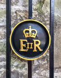 The Queen Elizabeth Royal Crest. On fence of London tower in the United Kingdom Stock Image