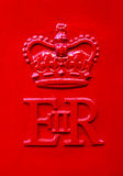 The Queen Elizabeth Royal Crest on a Red UK Post Box Royalty Free Stock Photos