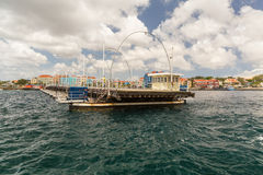 Queen Emma Bridge in Willemstad Curacao. The Queen Emma Bridge is a pontoon bridge across St. Anna Bay in Curaçao. It connects the Punda and Otrobanda quarters Royalty Free Stock Images