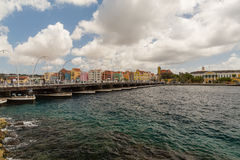 Queen Emma Bridge in Willemstad Curacao. The Queen Emma Bridge is a pontoon bridge across St. Anna Bay in Curaçao. It connects the Punda and Otrobanda quarters Royalty Free Stock Photos