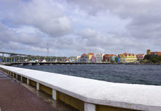 The Queen Emma pontoon bridge and colorful buildings. Royalty Free Stock Photo