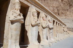 The Queen. Facade of the temple of the queen Hatsheput .. with her statues docrating the pillars Stock Photography