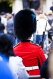 Queen guard. Surrounded by the crowd Royalty Free Stock Photography