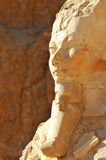 Queen Hatshepsut. Detail of the statue of Queen Hatshepsut at Thebes in Egypt with mountains in the background Royalty Free Stock Image