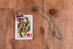 Queen of Hearts card with locket Royalty Free Stock Image