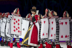 Queen of Hearts and Card Soldiers in Line Royalty Free Stock Photo