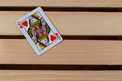 Queen of hearts. Card on a wooden background Stock Photography