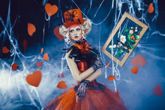 Queen of Hearts. Entered into the real world. Photo shoot in the style of the card game. Unusual, creative make-up, beautiful, funny dress. Vintage hairstyle stock photo
