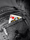 Queen of hearts in a pocket. Queen of hearts in a jeans pocket Royalty Free Stock Photography