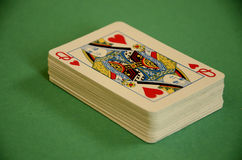 Queen of Hearts on Top a Deck of Playing Cards on Green Baize Royalty Free Stock Images