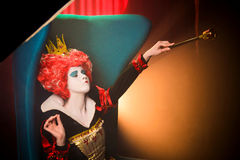 Queen of hearts waving a scepter Stock Images