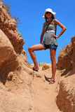Queen of the hill. Beautiful girl climbs to mountain. Crete, Greece Royalty Free Stock Photo