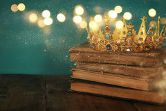 Queen/king crown on old book. vintage filtered. fantasy medieval period. Low key image of beautiful queen/king crown on old book. vintage filtered. fantasy stock photo