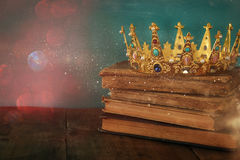 Queen/king crown on old book. vintage filtered. fantasy medieval period. Low key image of beautiful queen/king crown on old book. vintage filtered. fantasy Stock Photography