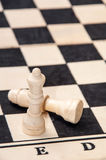 Queen and lying king on the chess table Royalty Free Stock Image