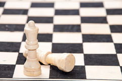 Queen and lying king on the chess table Stock Image