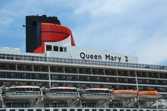 Queen Mary 2 cruise ship details. NEW YORK CITY - JULY 27: Queen Mary 2 cruise ship docked at Brooklyn Cruise Terminal on July 27, 2013. Queen Mary 2 is Cunard Stock Photos