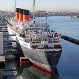 Queen mary Cruise ship in dock. The original Queen mary cruise ship in dock at Long Beach, California. Now used as a tourist resort with hotel rooms and tours Royalty Free Stock Photo