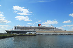 Queen Mary 2 cruise ship docked at Brooklyn Cruise Terminal. NEW YORK - AUGUST 15: Queen Mary 2 cruise ship docked at Brooklyn Cruise Terminal on August 15, 2013 Stock Photo