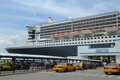 Queen Mary 2 cruise ship docked at Brooklyn Cruise Terminal. NEW YORK CITY - JULY 27: Queen Mary 2 cruise ship docked at Brooklyn Cruise Terminal on July 27 Stock Images